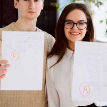 A man and a woman showing their GMAT exam scores