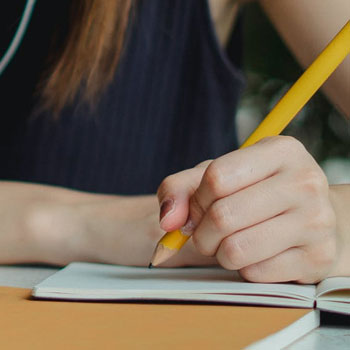 Writing answers on a notebook