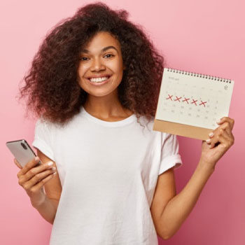 Woman holding a calendar and phone