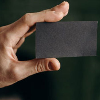 holding a blank piece of paper
