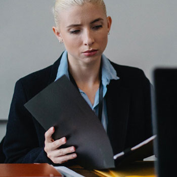 A woman reading papers