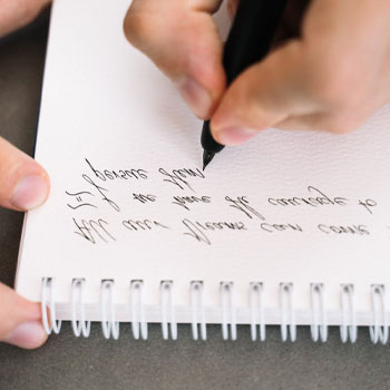 A man writing on a paper