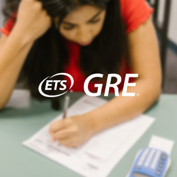 The logo of GRE with a woman taking an exam as background