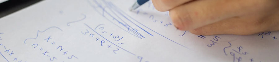 A person answering math equations on a paper