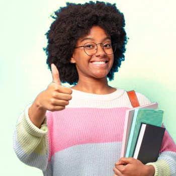 A female student carrying books and a bag with her thumbs up