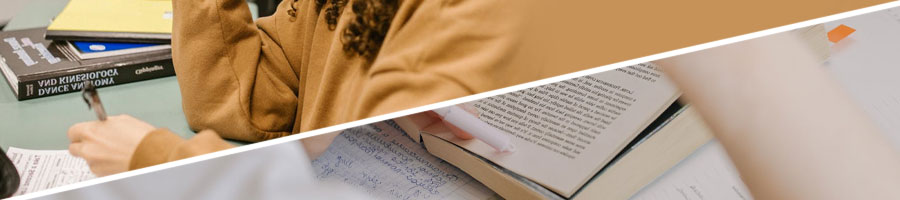 A woman writing on a test paper, person reading a book
