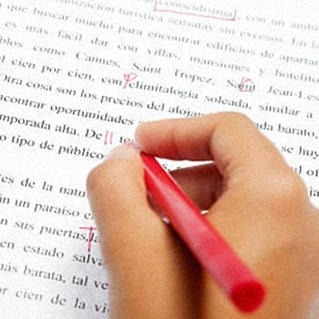 Close up photo of a hand correcting a sentence on GMAT