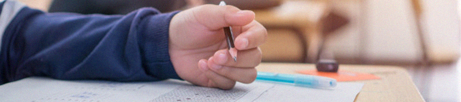 A person doing an exam inside a classroom
