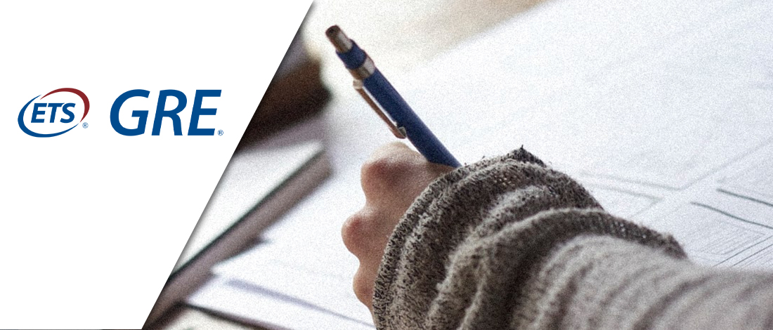 A person writing on a paper