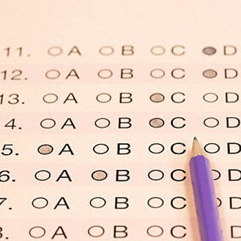 Close up answer sheet with a pencil on top