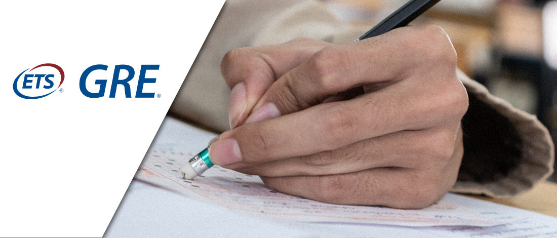 A person erasing the answer on his examination