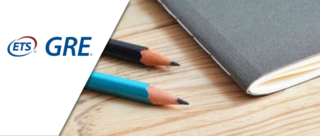 Two pencils and one notebook on top of a table