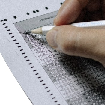 A student answering an answer sheet close up image