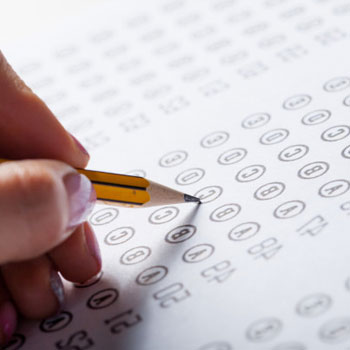 Close up image of a test paper getting shaded by a pencil