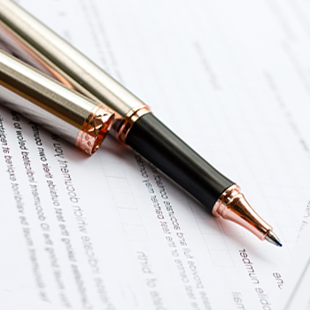 A pen and a recommendation letter