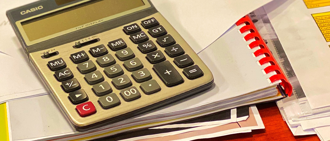 Calculator on a stacked documents