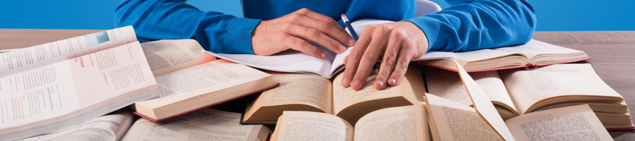 Man reading opened books at the same time