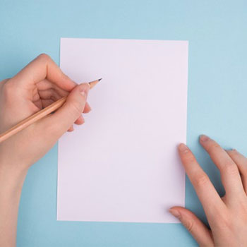 Empty white paper and a person holding a pencil