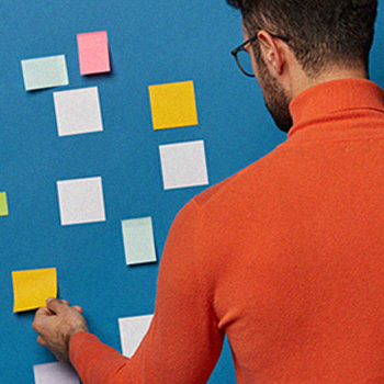 A person using sticky notes to organize his plans
