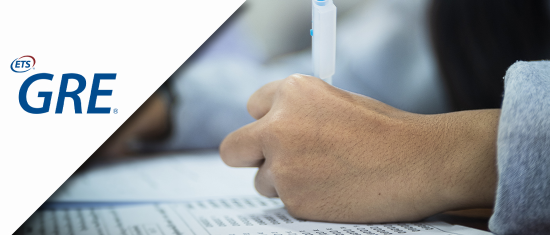 A person answering an exam combined with the GRE logo