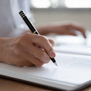 A person writing a long paragraph