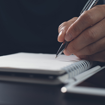 A person writing notes