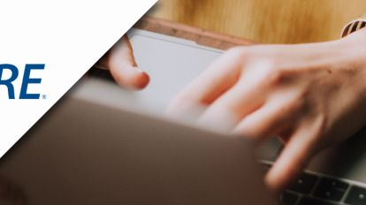 A picture of a woman typing on her laptop combined with GRE logo